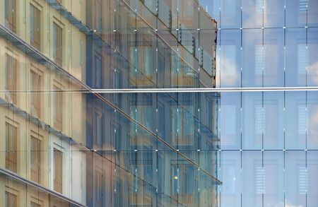 adjacent: Glass facade with reflection of adjacent buildings