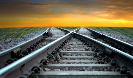 Landscape with railroad disappearing into sunset