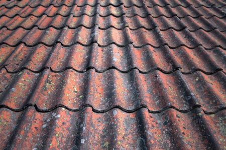 Background with close up of tiles on roof photo