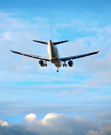 landing light: Rear view of aircraft on blue cloudy sky Stock Photo