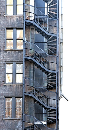 fire escape on run down building with brick wall