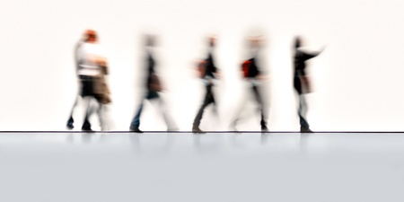 Blurred people in motion with sparse background Standard-Bild