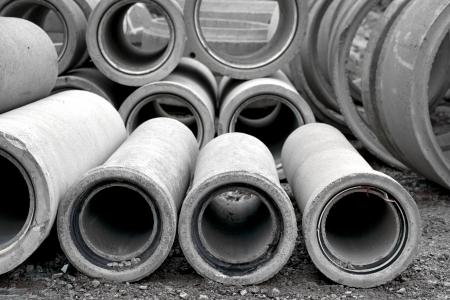 cement pile: Heap of concrete pipes on construction site