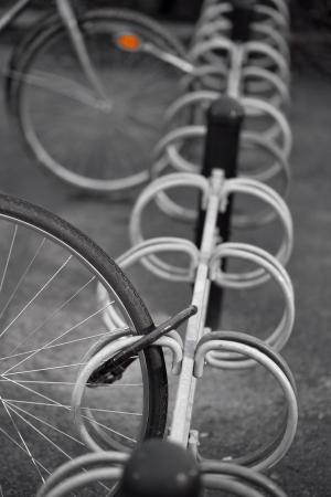 locked up: Locked wheel of bicycle in bicycle rack