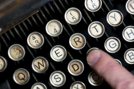 Close up of keys of vintage typewriter with finger in blurred motion Stock Photo - 16574503