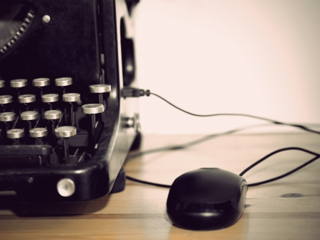 Computer mouse connected to vintage typewriter Stock Photo - 16574507