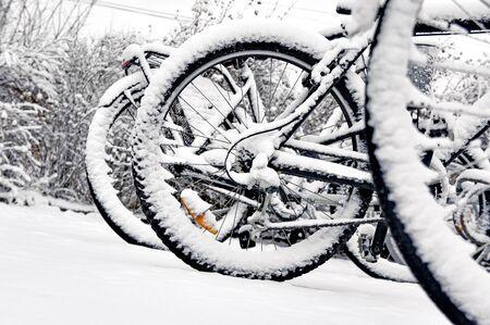 rack wheel: Close up of wheel of bike in bicycle rack in winter Stock Photo
