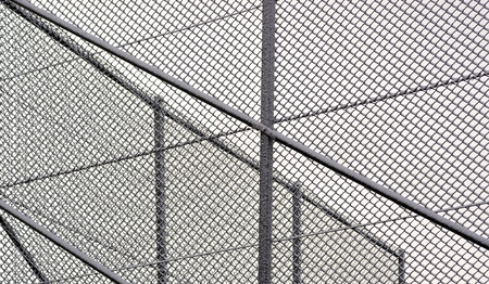 Chainlink fence with snow in corner of soccer field