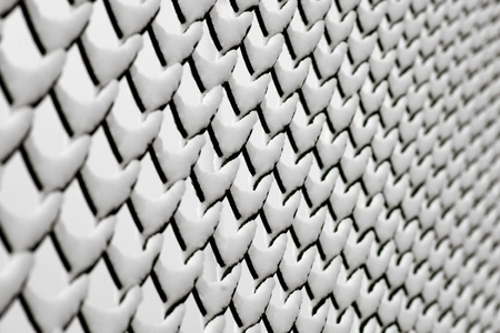 Chainlink fence with snow at an angle, with diminishing perspective Stock Photo - 16651877