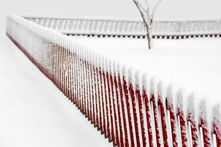 sparse: Red wooden fence in sparse snowy landscape Stock Photo