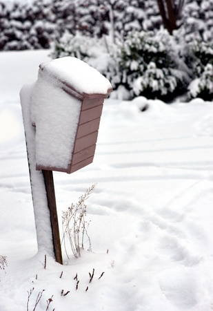 wooden mailbox in rural area covered in snow Stock Photo - 16651958