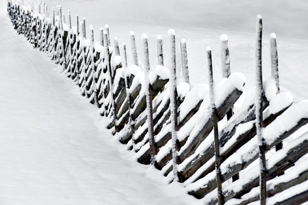 Traditional scandinavian wooden fence in field in winter Stock Photo - 16651807