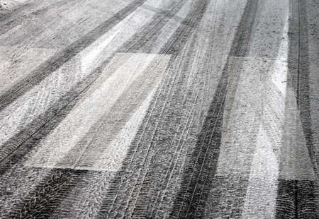zebra crossing: pedestrian crossing with snow and tyre prints