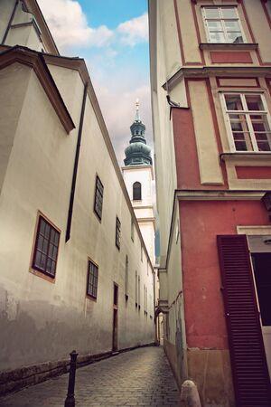 jesuit: Narrow street in Vienna, with Jesuit Church (Jesuitenkirche) in background