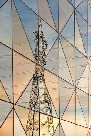electricity pylon: Electricity pylon reflected in glass facade