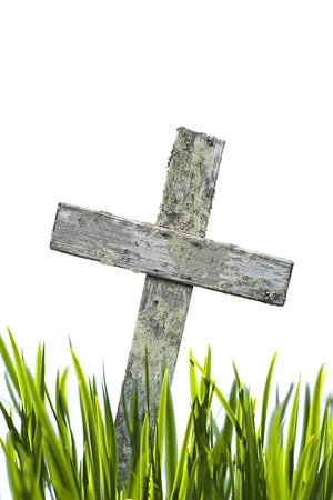 burial: wooden cross and grass isolated on white Stock Photo