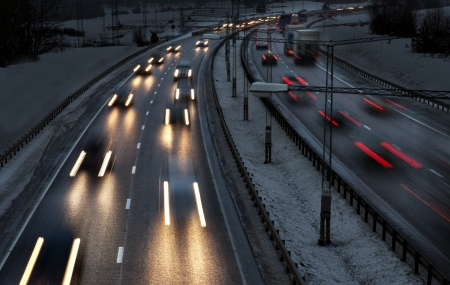 Highway with busy traffic on winter evening photo