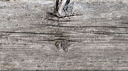 knotting: Background with weathered textured cracked knotted wood