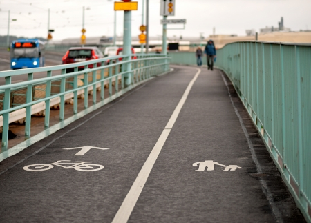 pedestrian walkway: pedestrian walkway and bicycle path on bridge with busy traffic Stock Photo