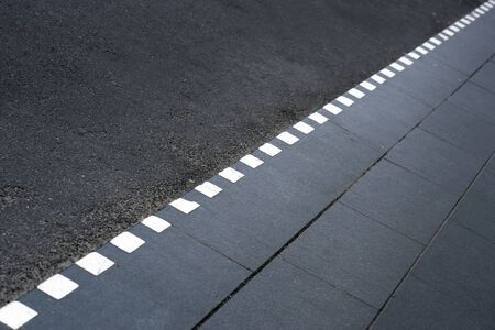 sparse: Sparse composition with dotted line on sidewalk Stock Photo