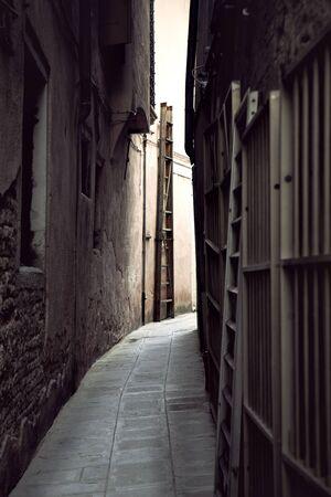 Narrow street in vintage style in Venice, Italy Stock Photo