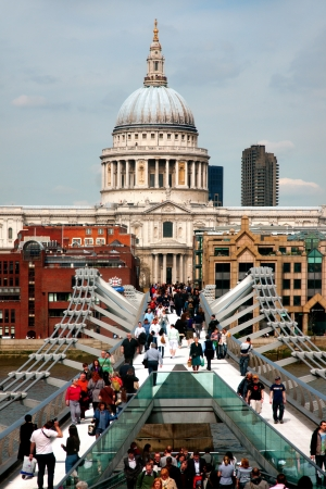 St Pauls cathedral and millennium bridge with crowd of people