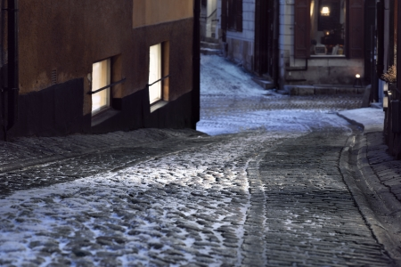 cobblestone street: Narrow street with cobble stones in the old town of Stockholm, Sweden