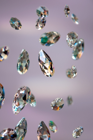 Close up of sparkling diamonds with purple background photo