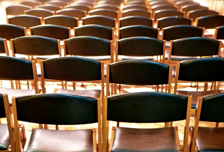 Rows of wooden chairs waiting for people to sit in them Stock Photo - 18525103