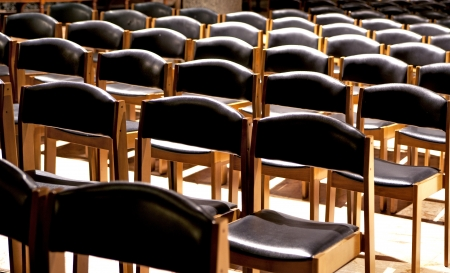 Rows of wooden chairs waiting for people to sit in them Stock Photo - 18525099