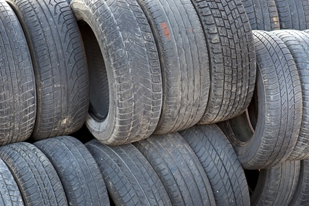 Background with stack of old used rubber tyres Stock Photo - 19188322