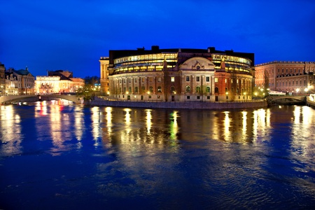 swedish: Stockholm parliament building at night, with old town and royal palace in background Stock Photo