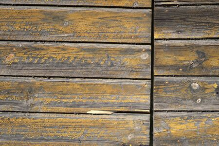 knotting: Background of flaking old knotted yellow wood