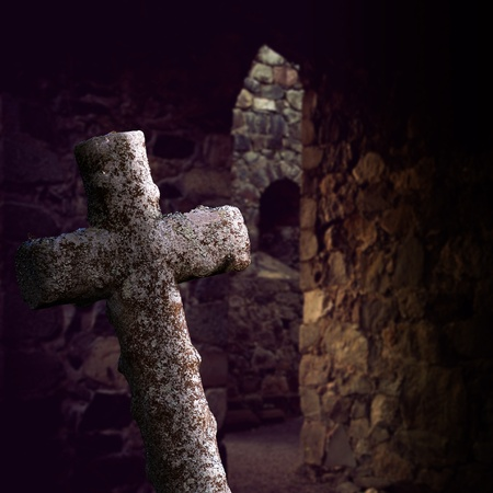 crypt: old stone cross in  ancient church ruin Stock Photo