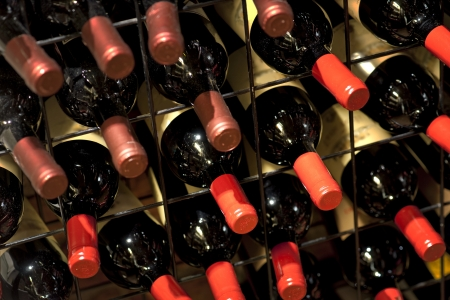 maturing: Rack in wine cellar with resting bottles Stock Photo