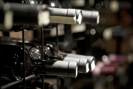 cellars: Detail from wine cellar with resting bottles