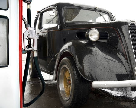 Vintage car at gas station, ready to be filled up photo