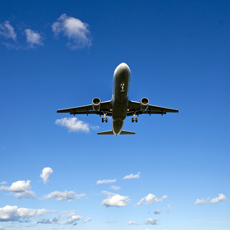 aircraft landing: low angle view of aircraft on blue sky Stock Photo