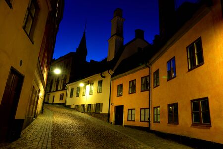 strret: Narrow strret in old part of Stockholm at night Stock Photo