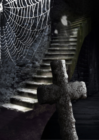 crypt: Spooky cellar with ancient stone cross, cobweb and ghost in staircase Stock Photo