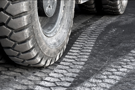 big wheel: close up of truck wheel and tire print on asphalt