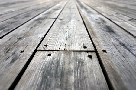 knotting: Close up of rough weathered wooden floor