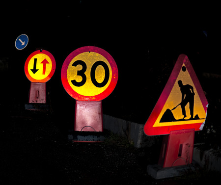 Roadworks with speed limit at night photo