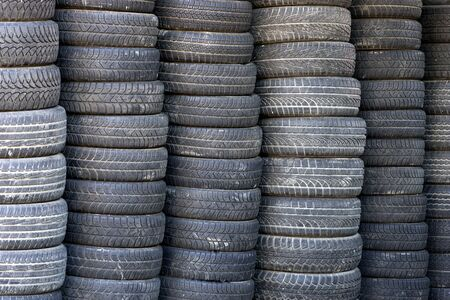 Background with stack of black used rubber tires photo