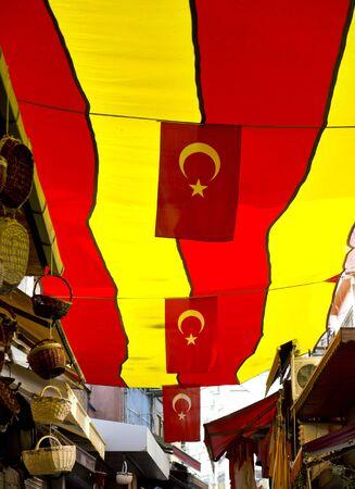 tarpaulin: Tarpaulin with turkish flags at Istanbul bazaar
