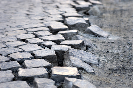 uneven edge: cubic stones in uneven pattern on the edge of the street Stock Photo