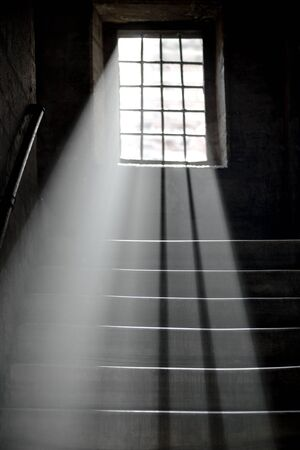shining through: Light shining through window in ancient staircase