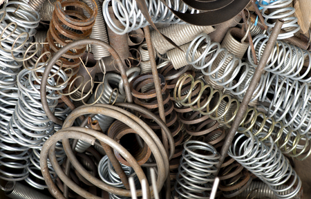 background with metal springs in different shapes Stock Photo