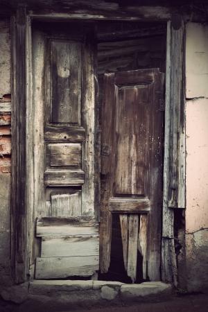 slum: Grunge ancient broken wooden door in slum area
