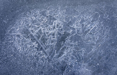 Ice crystals making patterns in frozen lake photo